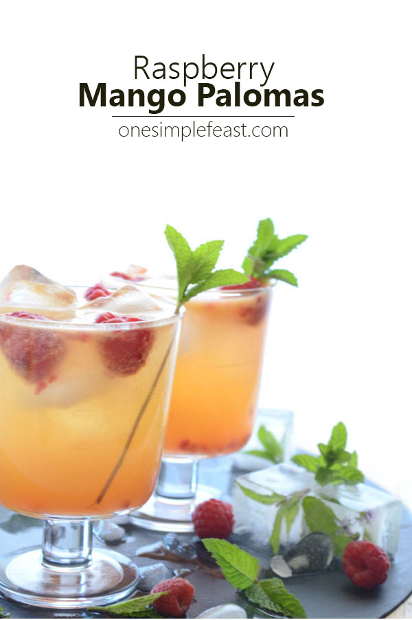 A delicous sweet tart Raspberry Mango Paloma cocktail, made with Trader Joes Mango Lemonade, fresh summer raspberries & Patron's Mango Citronage. | onesimplefeast.com