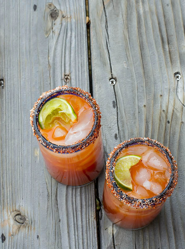 This Life Changing Spicy Michelada is a spicy Mexican take on the classic beer + tomato juice, spiced up with a zesty lime + salt rim for that extra bite!